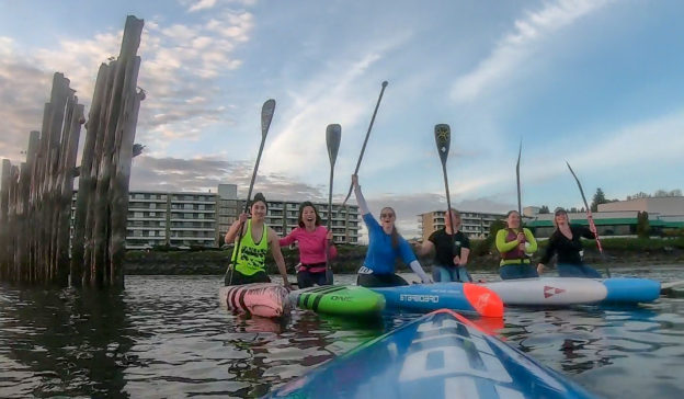 group of women sup paddlers